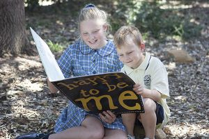 St Mary - St Joseph Catholic Primary School Maroubra- students reading a happy to be me book